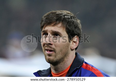 MILAN, ITALY-APRIL 23, 2009: FC Barcelona soccer player Lionel Messi portrait at the San Siro soccer stadium during the UEFA Champions League match AC Milan vs FC Barcelona, in Milan.  - stock photo
