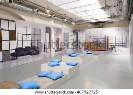 MILAN, ITALY-APRIL 14, 2016: furniture design exhibition on an industrial space during the Fuori Salone Design Week of the International Salone del Mobile, in Milan.