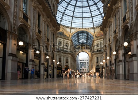 MILAN, ITALY - APRIL 12 2015: Galleria Vittorio Emanuele II in Milan is one of the world's oldest shopping malls was designed in 1861 and built by Giuseppe Mengoni between 1865 and 1877. - stock photo