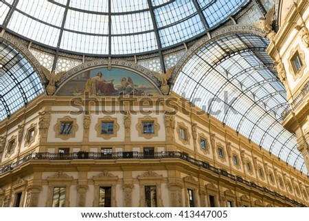 Milan, Italy - April 11: Interiors of Galleria Vittorio Emanuele II on April 11, 2016. Built in 1875 this gallery is one of the most popular shopping areas in Milan. - stock photo