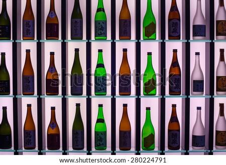MILAN, ITALY - APRIL 16: Japanese Sake bottles displayed at Tokyo design pavilion at Tortona space location of important events during Milan Design week on April 16, 2015 - stock photo