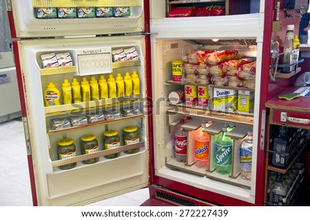 MILAN, ITALY-APRIL 17, 2015: mc donald's fast food refrigerator displayed during the Arts and Foods exhibition at the architecture, design and arts museum La Triennale, in Milan. - stock photo