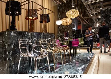 MILAN, ITALY - APRIL 14: Milan Design Week, people at Kartell stand at Salone del Mobile opening on April 14, 2015 in Milan. - stock photo