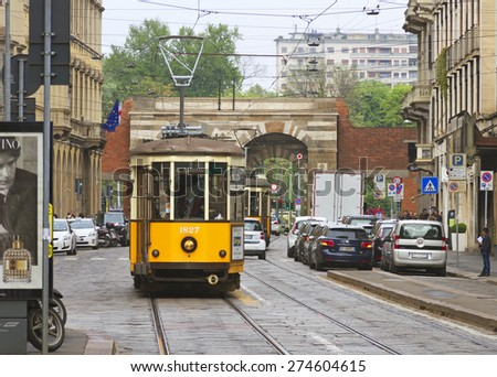 MILAN, ITALY - 26 APRIL: Milan is the second-most populous city in Italy and the capital of Lombardy. Old orange tram on the street of Milan, Italy on 26 April, 2015. - stock photo