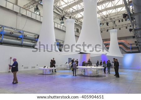 MILAN, ITALY - APRIL 13: People visit Asus pavilion at Fuorisalone, set of events distributed in different areas of the town during Milan Design Week on APRIL 13, 2016 in Milan. - stock photo