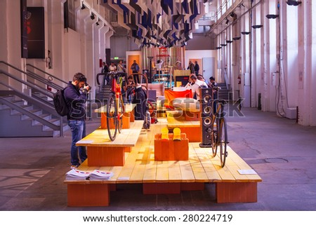 MILAN, ITALY - APRIL 16: People visit Fuorisalone at Tortona space location of important events during Milan Design week on April 16, 2015 - stock photo