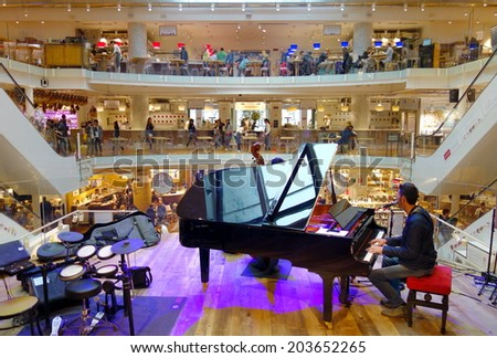 MILAN, ITALY - APRIL 27, 2014: The inside of one of the famous supermarkets Eataly in Milan, Italy.  - stock photo