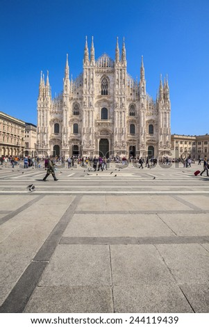 MILAN, ITALY - APRIL 9, 2010: Tourists visiting in daylight the Piazza Duomo square in Milan, Italy. In year 2015 in this city will take place the Milano Expo. - stock photo