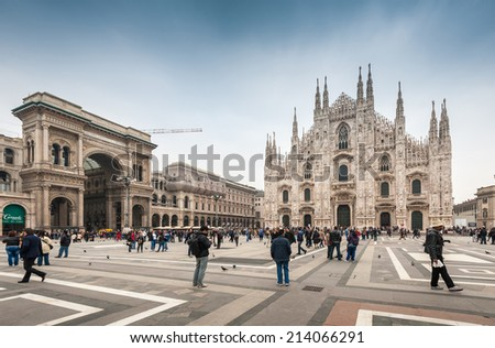 MILAN, ITALY - APRIL 10, 2013: Tourists visiting the Piazza Duomo square in Milan Italy