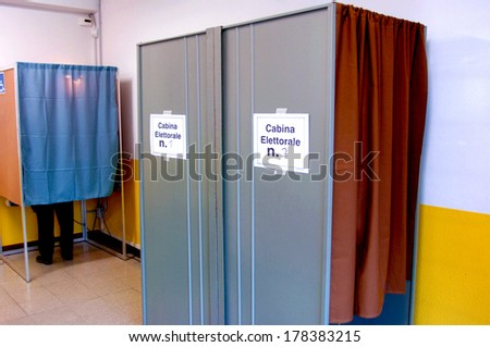 MILAN, ITALY-APRIL 11, 2006: Unrecognizable person votes inside a polling booth during the italian political elections. - stock photo