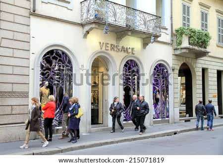 MILAN, ITALY - APRIL 20, 2014: Versace store and people walking by in Via Montenapoleone in Milan, Italy. - stock photo