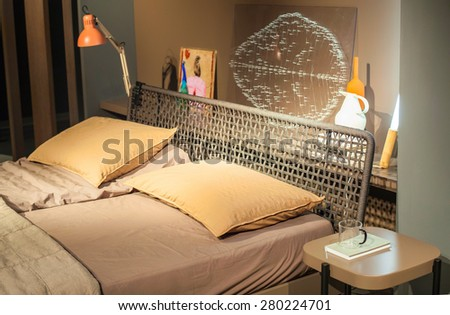 MILAN, ITALY - APRIL 16: View of bed displayed at Tortona space location of important events during Milan Design week on April 16, 2015 - stock photo