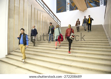 MILAN, ITALY-APRIL 17, 2015: visitors inside the architecture, design and arts museum La Triennale, in Milan. - stock photo