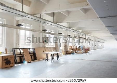MILAN, ITALY - APRIL 15:  White, messy industrial interior before preparation during Milan design week on April 15, 2015 in Milan. - stock photo