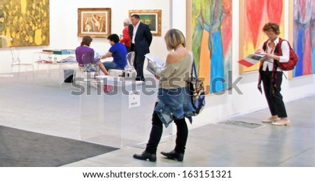 MILAN, ITALY - APRIL 08: Women looking at paintings galleries during MiArt, international exhibition of modern and contemporary art on April 08, 2011 in Milan, Italy  - stock photo