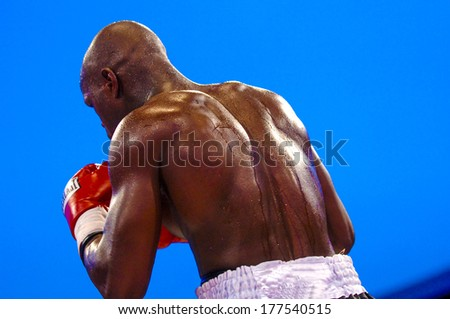 MILAN, ITALY-AUGUST 28, 2006: Boxer man fighting during a professional Boxing Championship. - stock photo
