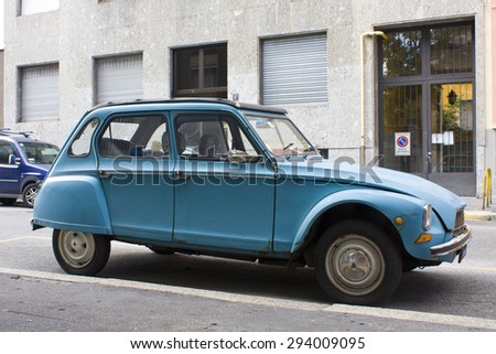 MILAN, ITALY-AUGUST 9, 2014: French motor car Citroen 2CVs Parked in the city - stock photo