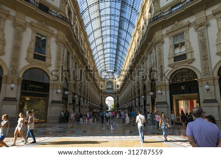 MILAN, ITALY - AUGUST 28 : View of Galleria Vittorio Emanuele II in Milan on August 28, 2015. Built in 1875 this gallery is one of the most popular shopping areas in Milan.