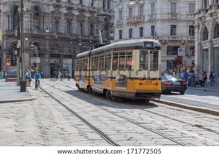 MILAN, ITALY - CIRCA AUGUST 2013: Yellow tram on the street.
