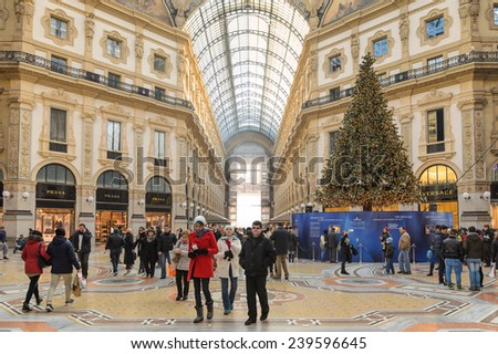 MILAN, ITALY - DEC 23, 2014: Christmas tree in the Galleria Vittorio Emanuele II, one of the world's oldest shopping malls. - stock photo