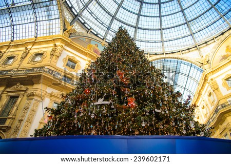 MILAN, ITALY - DEC 23, 2014: Christmas tree in the Galleria Vittorio Emanuele II, one of the world's oldest shopping malls. The gallery is built between 1865 and 1877 by Giuseppe Mengoni - stock photo