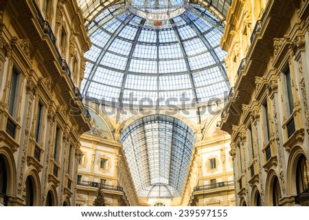 MILAN, ITALY - DEC 23, 2014: Galleria Vittorio Emanuele II, one of the world's oldest shopping malls. The gallery is built between 1865 and 1877 by Giuseppe Mengoni - stock photo