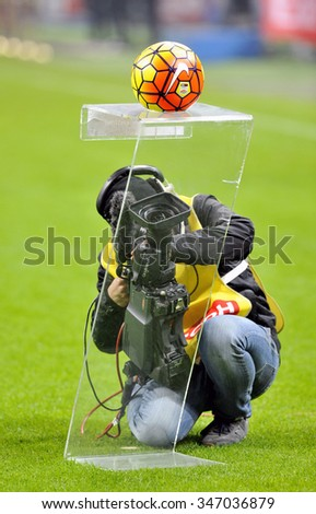 MILAN, ITALY-DECEMBER 01, 2015: cameraman filming the official soccer ball during the Italy Cup match at san siro stadium AC Milan vs Crotone, in Milan.
