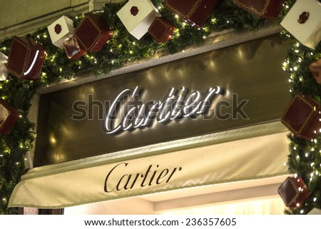 MILAN, ITALY-DECEMBER 02, 2014: Cartier brand name outside a boutique store in the downtown fashion district, in Milan.