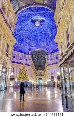 MILAN, ITALY - DECEMBER 31: Galleria Vittorio Emanuele II decorated for Christmas on December 31, 2014 in Milan, Italy. Built in 1875 is one of the world's oldest shopping malls. - stock photo