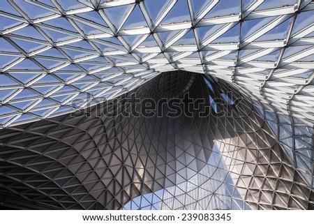MILAN,ITALY - DECEMBER 08:Interior of Fieramilano Business Center, modern glass ant steel building, on December 08, 2014, Milan, Italy. - stock photo