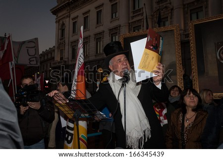 MILAN, ITALY - DECEMBER 7: Workers gather in front of La Scala opera house to protest during the premiere of La Traviata on DECEMBER 7, 2013 in Milan.