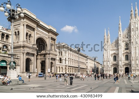 MILAN, ITALY, EU  SEPTEMBER 12, 2011: Piazza del Duomo or Cathedral Square , overlooking the Cathedral and the arched entrance to the galleries Vittorio Emmanuelle II