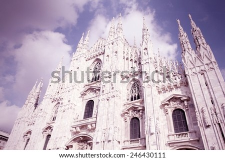 Milan, Italy. Famous landmark - the cathedral made of Candoglia marble. Cross processed color tone - retro image filtered style. - stock photo