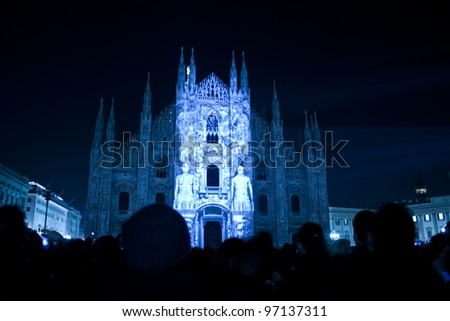 MILAN, ITALY- FEB 28: Duomo of Milan on February 28, 2012, Milan. On Duomo facade for the start of lent, were projected video content that visually interact with their structure, without altering it. - stock photo