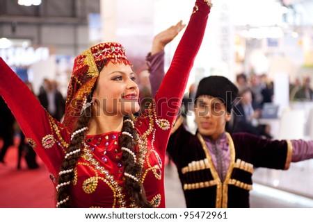 MILAN, ITALY - FEBRUARY 17: Azerbaijan dancers at BIT International Tourism Exchange on february 17, 2012 in Milan, Italy. - stock photo