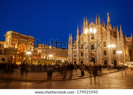 MILAN, ITALY - FEBRUARY 22: Cathedral Square with Milan Cathedral and Galleria Vittorio Emanuele II and unidentified people on February 22, 2014 in Milan. It's a famous place with great architecture. - stock photo