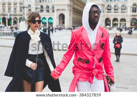 MILAN, ITALY - FEBRUARY 29, 2016: Fashionable couple attending models and vips in the streets during Milan Fashion Week Women Fall/Winter 2015/2016