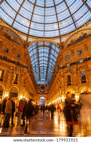 MILAN, ITALY - FEBRUARY 22: Galleria Vittorio Emanuele II with unidentified people on February 22, 2014 in Milan. It's one of world's oldest shopping malls, housed within a four-story double arcade. - stock photo