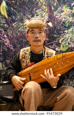 MILAN, ITALY - FEBRUARY 17: Malaysian player performs at BIT International Tourism Exchange on february 17, 2012 in Milan, Italy. - stock photo