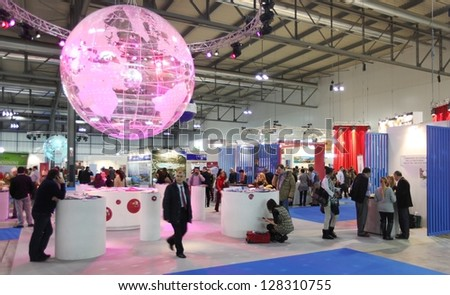 MILAN, ITALY - FEBRUARY 15: People at the light globe during BIT, International Tourism Exchange Exhibition on February 15, 2013 in Milan, Italy. - stock photo