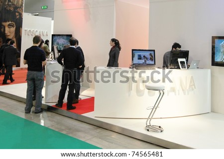 MILAN, ITALY - FEBRUARY 20: People at Tuscany stand, Italy tourism pavilion, during BIT, International Tourism Exchange Exhibition on February 20, 2011 in Milan, Italy. - stock photo