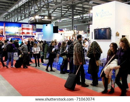MILAN, ITALY - FEBRUARY 20: People crowd visit BIT, International Tourism Exchange Exhibition February 20, 2010 in Milan, Italy.
