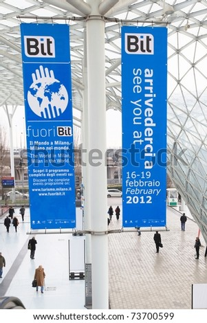 MILAN, ITALY - FEBRUARY 20: People entering World and Italy tourism pavilions during BIT, International Tourism Exchange Exhibition on February 20, 2011 in Milan, Italy. - stock photo