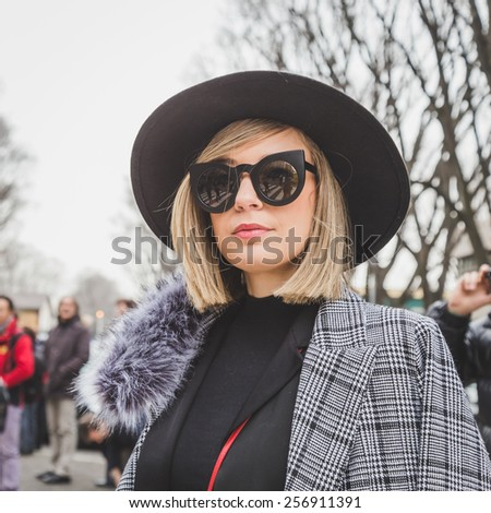 MILAN, ITALY - FEBRUARY 27: People gather outside Armani fashion show building for Milan Women's Fashion Week on FEBRUARY 27, 2015  in Milan.
