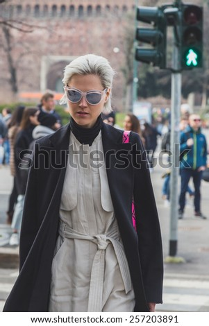 MILAN, ITALY - FEBRUARY 28: People gather outside Jil Sander fashion show building for Milan Women's Fashion Week on FEBRUARY 28, 2015  in Milan.
