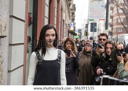 MILAN, ITALY - FEBRUARY 26: People gather outside Sportmax fashion show during Milan Women's Fashion Week on FEBRUARY 26, 2016 in Milan.