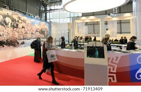 MILAN, ITALY - FEBRUARY 17: People visit tourism stands at Italy showtrade pavilion during BIT, International Tourism Exchange Exhibition on February 17, 2011 in Milan, Italy. - stock photo