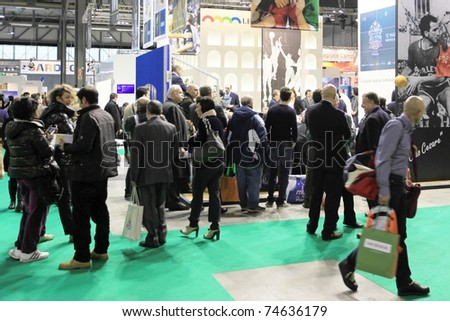 MILAN, ITALY - FEBRUARY 20: People visit World and Italy tourism pavilions during BIT, International Tourism Exchange Exhibition on February 20, 2011 in Milan, Italy. - stock photo