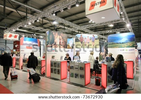 MILAN, ITALY - FEBRUARY 20: People visit World tourism pavilion during BIT, International Tourism Exchange Exhibition on February 20, 2010 in Milan, Italy. - stock photo