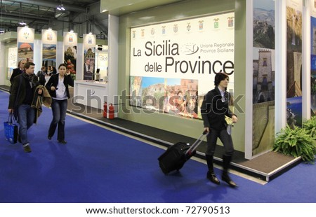 MILAN, ITALY - FEBRUARY 17: People visiting Sicily regional stand at Italian pavilion tourism during BIT International Tourism Exchange Exhibition on February 17, 2011 in Milan, Italy. - stock photo